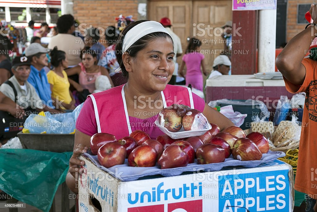 Woman selling apples in Nicaragua stock photo
