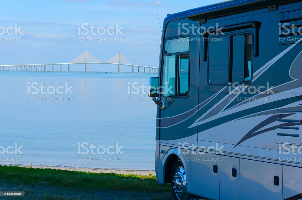 RV at beach with Tampa Bay Skyway Bridge stock photo