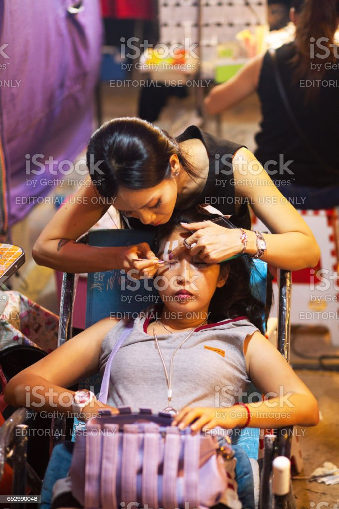 At cosmetic market stall on nigth market in Bangkok stock photo