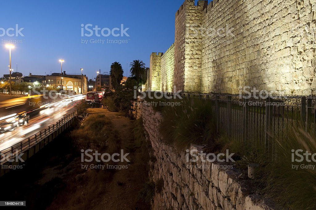 Old City walls and traffic outside Jaffa Gate in Jerusalem royalty-free stock photo