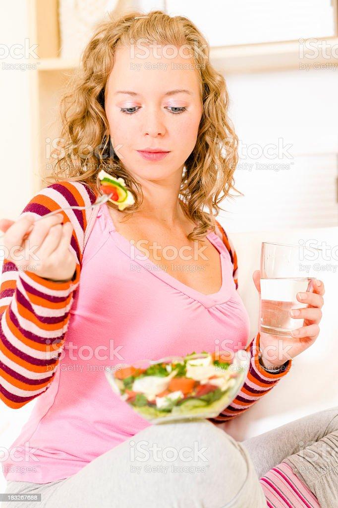 At home: eating delicious salad royalty-free stock photo