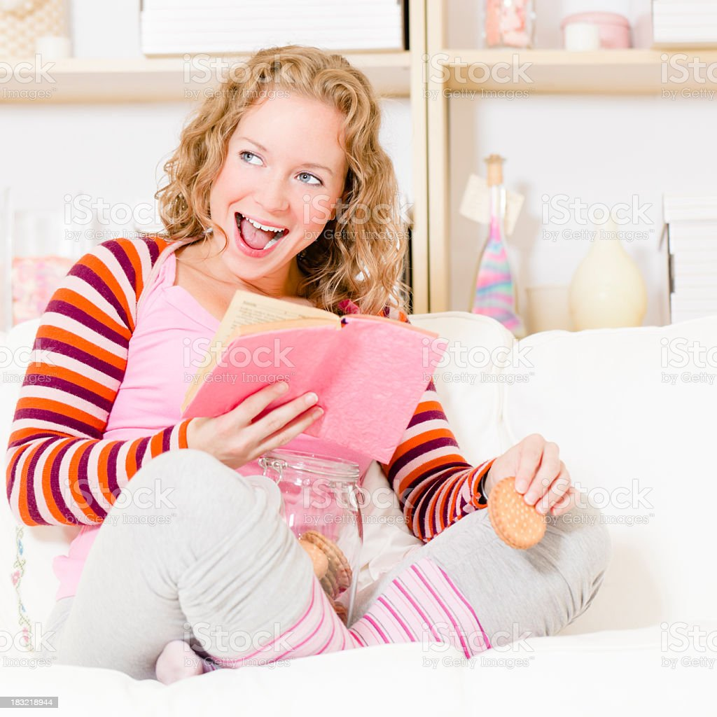 At home: reading and laughing royalty-free stock photo