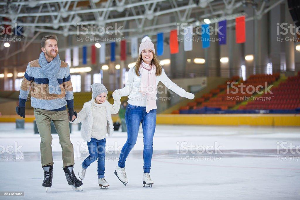 At ice-skating rink stock photo