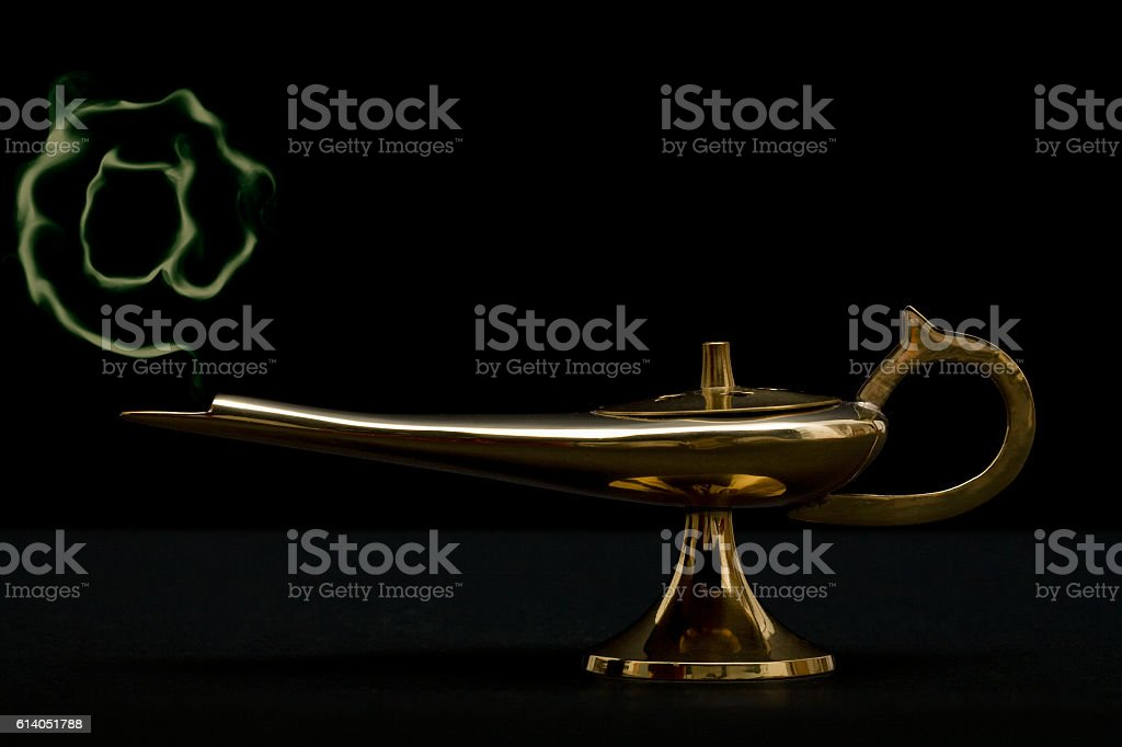 At sign coming out from magic lamp stock photo