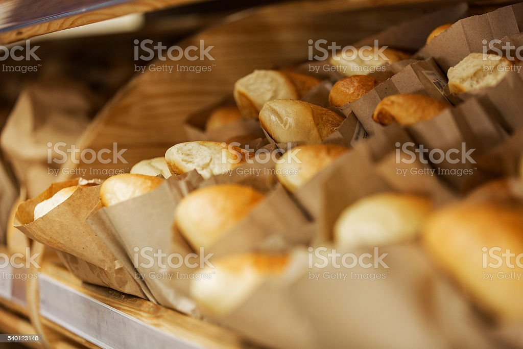 At the bakery. Shelf with loaves of white bread stock photo