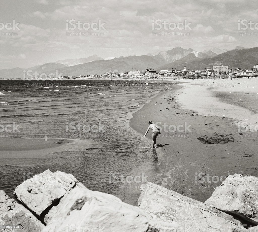 At the beach - bather with a beautiful landscape stock photo