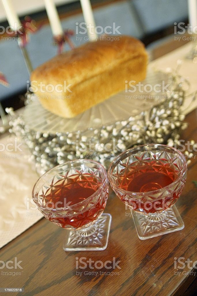 At the Communion Table with Wine and Bread stock photo