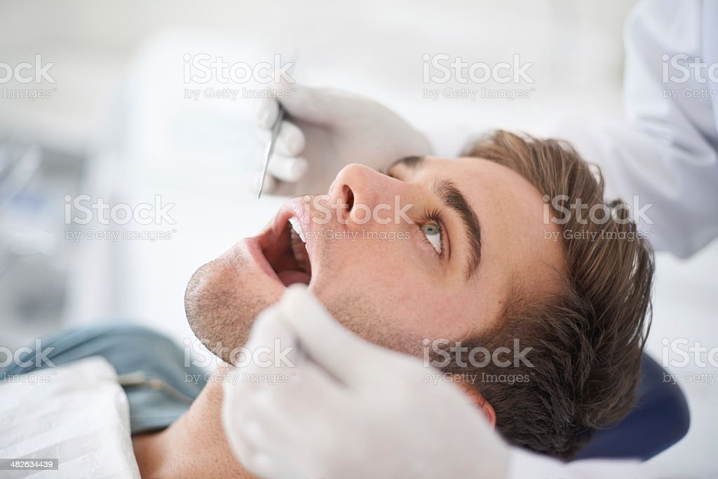 At the dentist for a routine checkup royalty-free stock photo