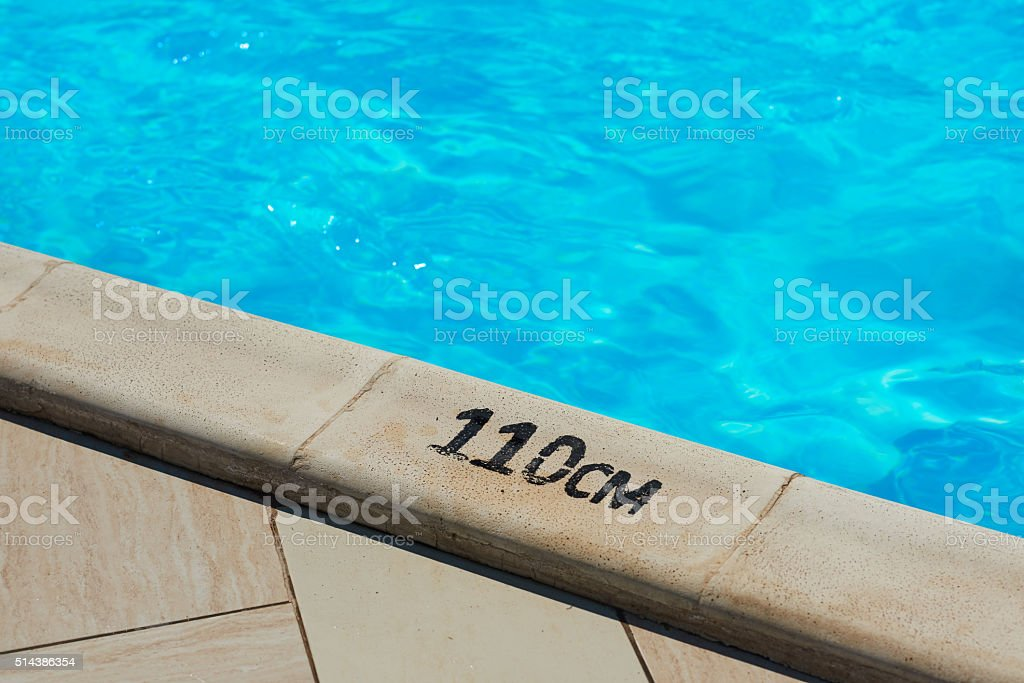 at the edge of swimming pool stock photo