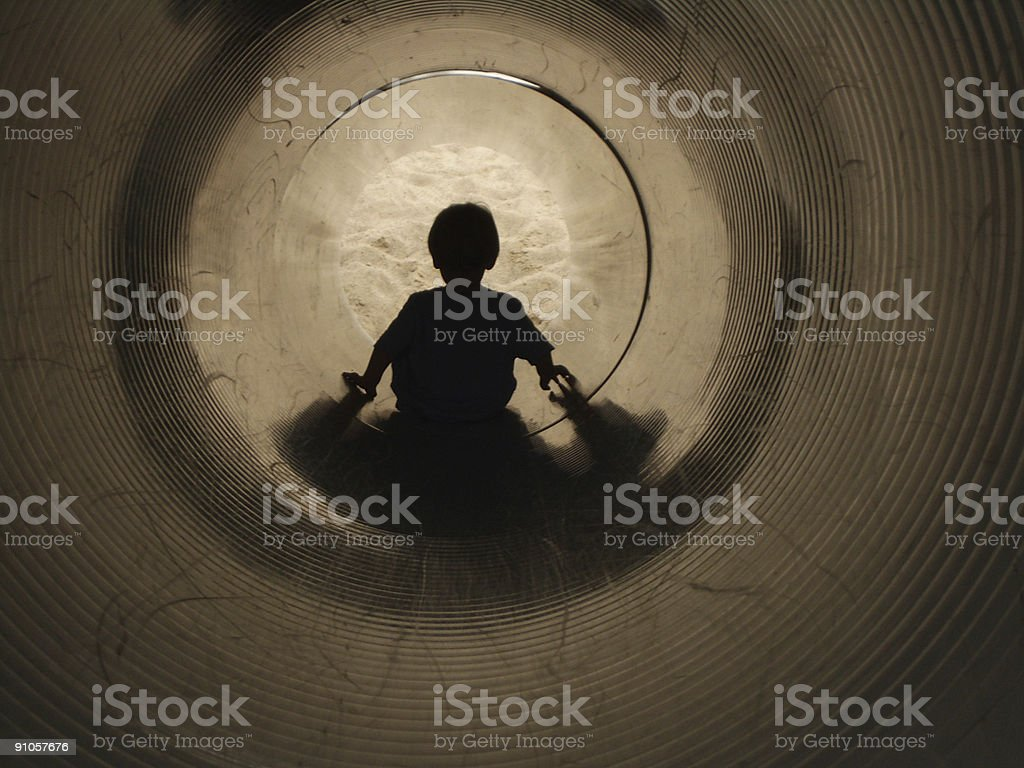 At The End of a Tunnel: Boy on Slide royalty-free stock photo