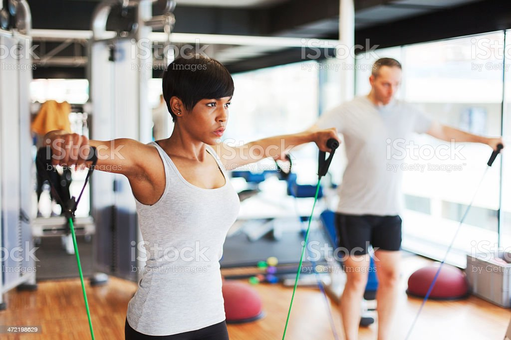At the gym working out with resistance bands. stock photo
