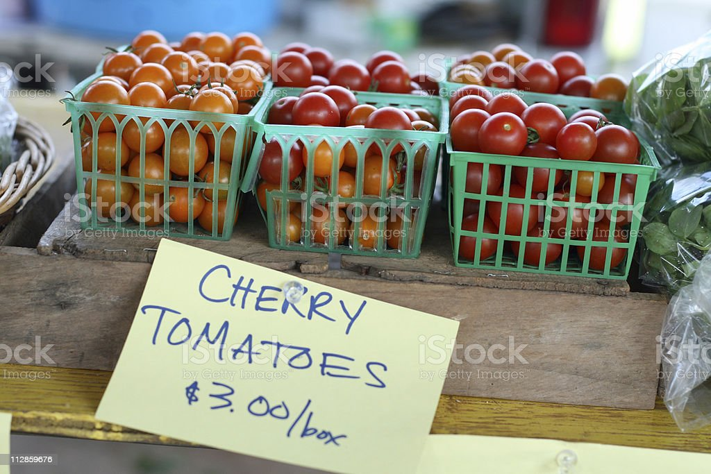 at the market: cherry tomatoes stock photo