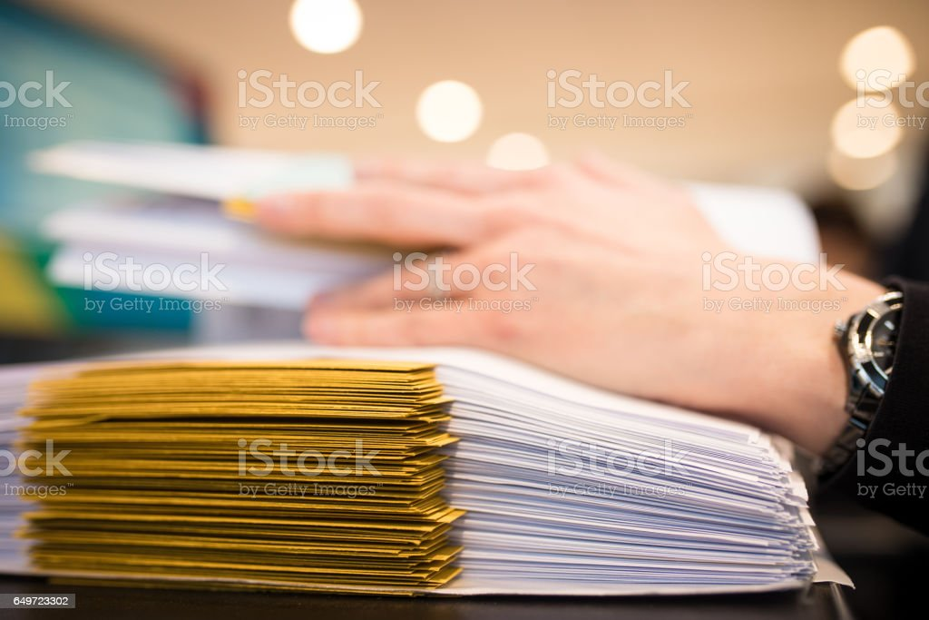 At the office working on files stock photo