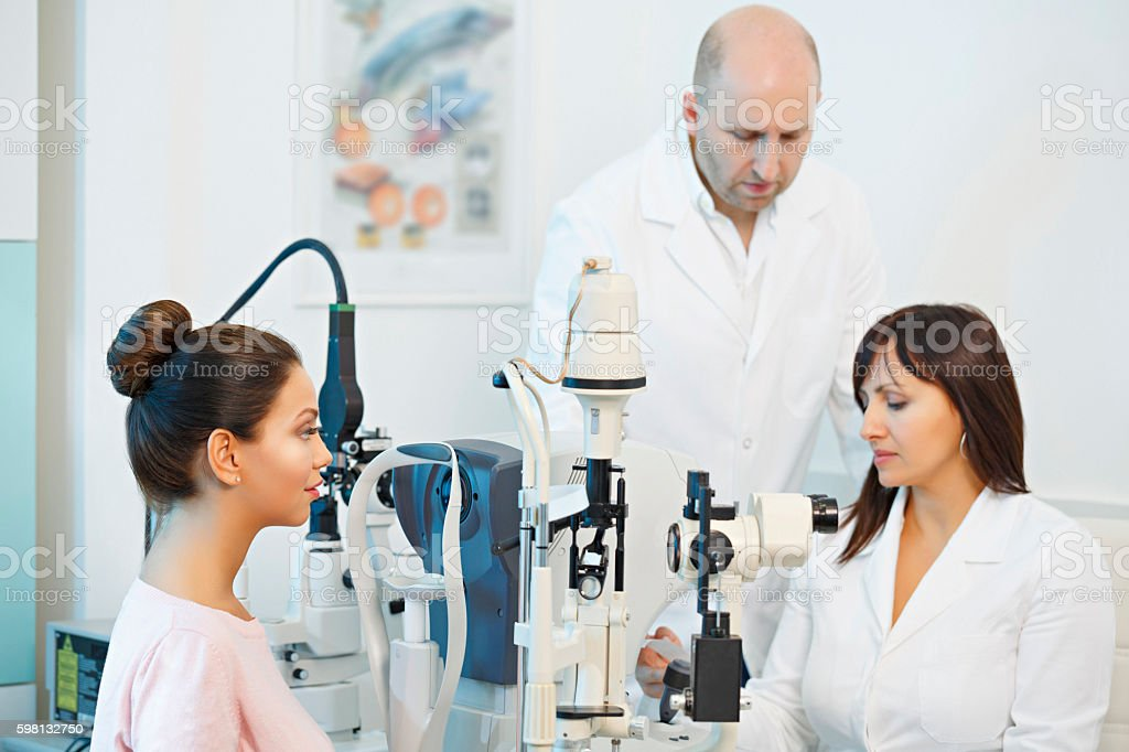 At the optician   Doctor ophthalmologist   Optometrist medical eye examination stock photo