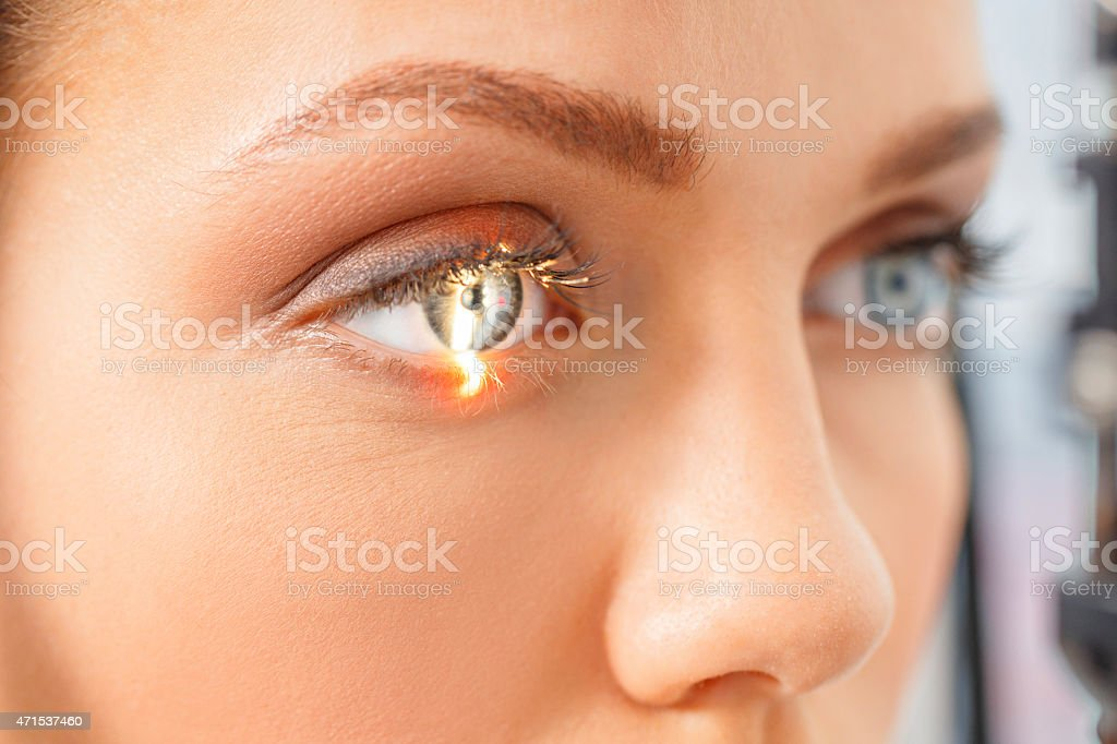 At the optician   Ophthalmology     Optometrist medical eye examination stock photo