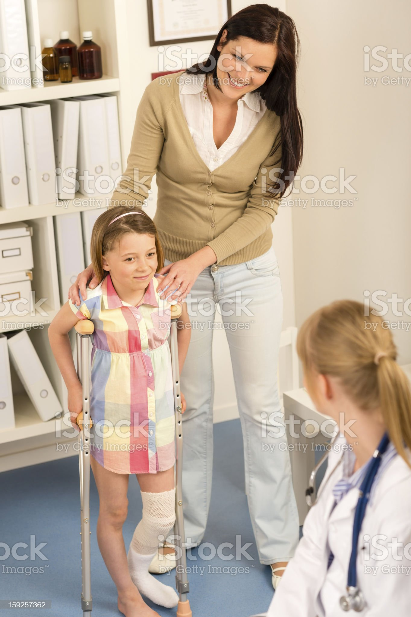 At the pediatrician little girl with crutches royalty-free stock photo