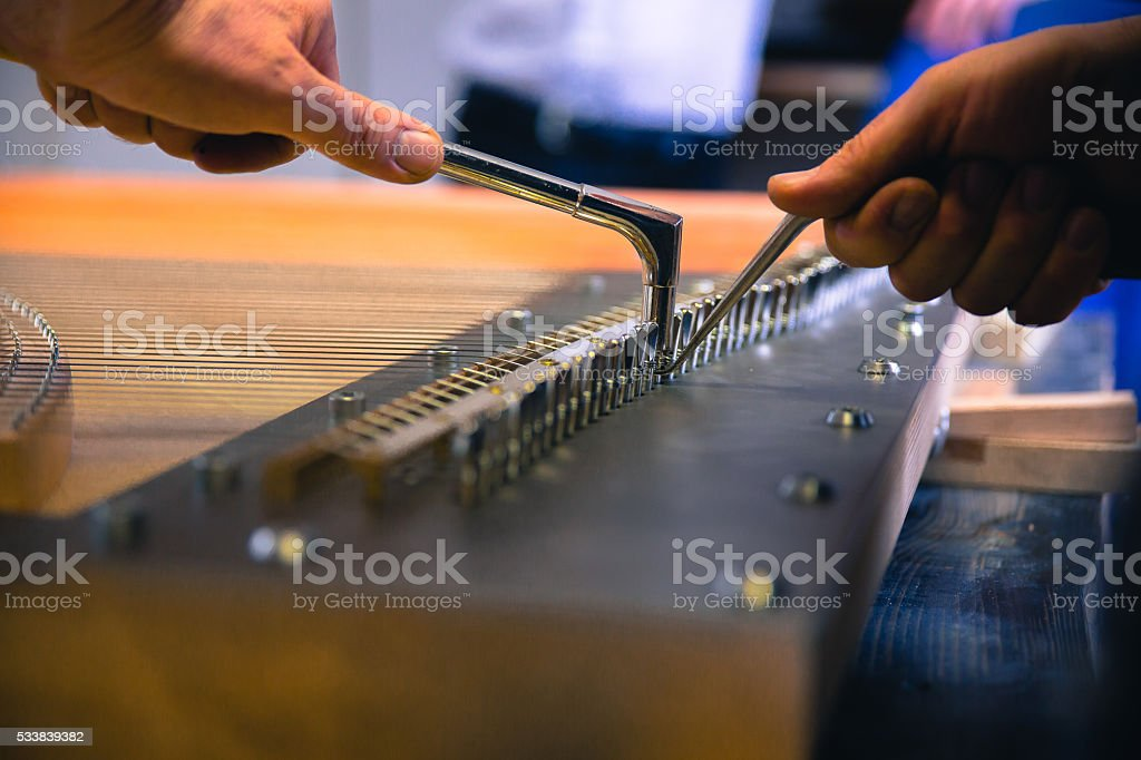 at the piano workshop stock photo