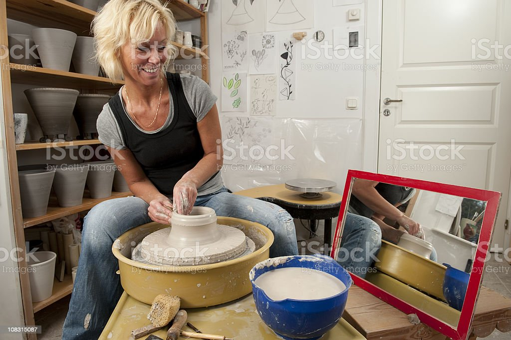 At the pottery wheel stock photo
