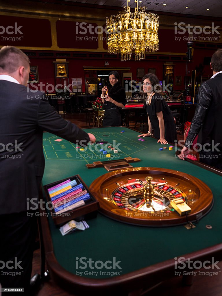 At the roulette table in Casino stock photo