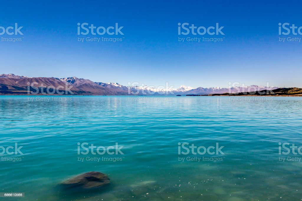 At the shore of Lake Pukaki stock photo