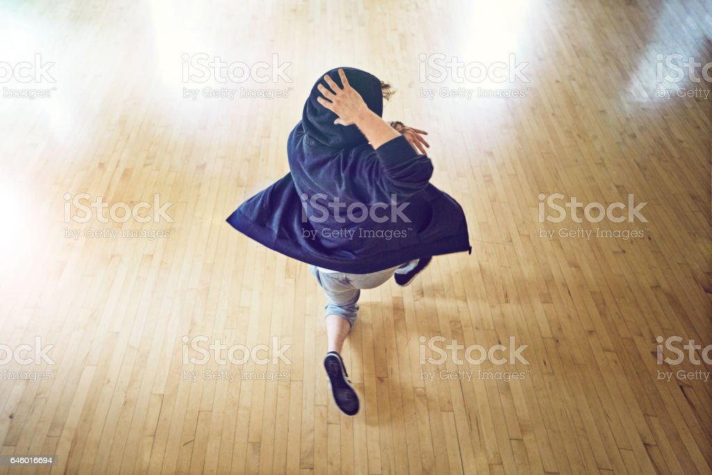 At the top of his dance game stock photo