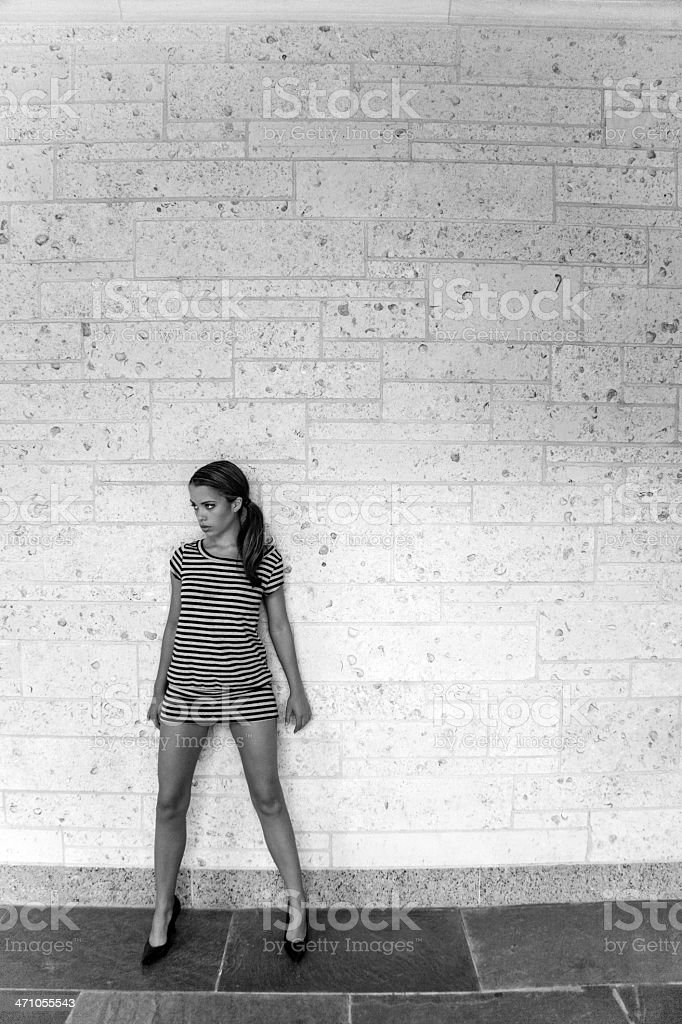 At the Wall, Woman Portrait BW royalty-free stock photo