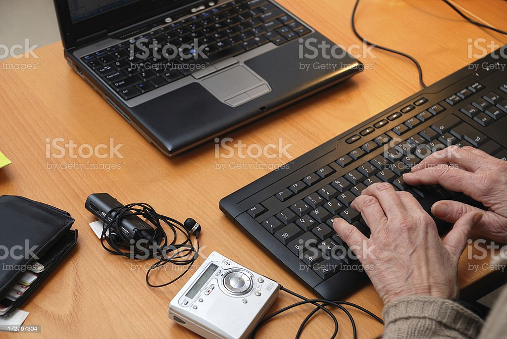 at work - desk from above with minidisc senior-woman typing royalty-free stock photo