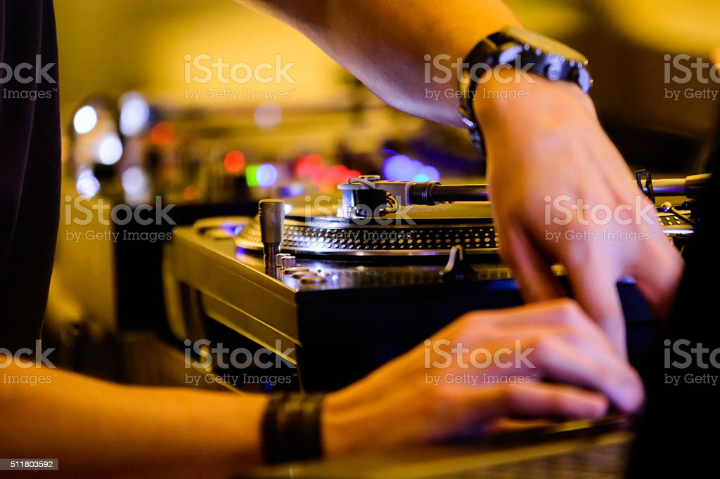 DJ at work plaing it's music and entertaining the crowd stock photo