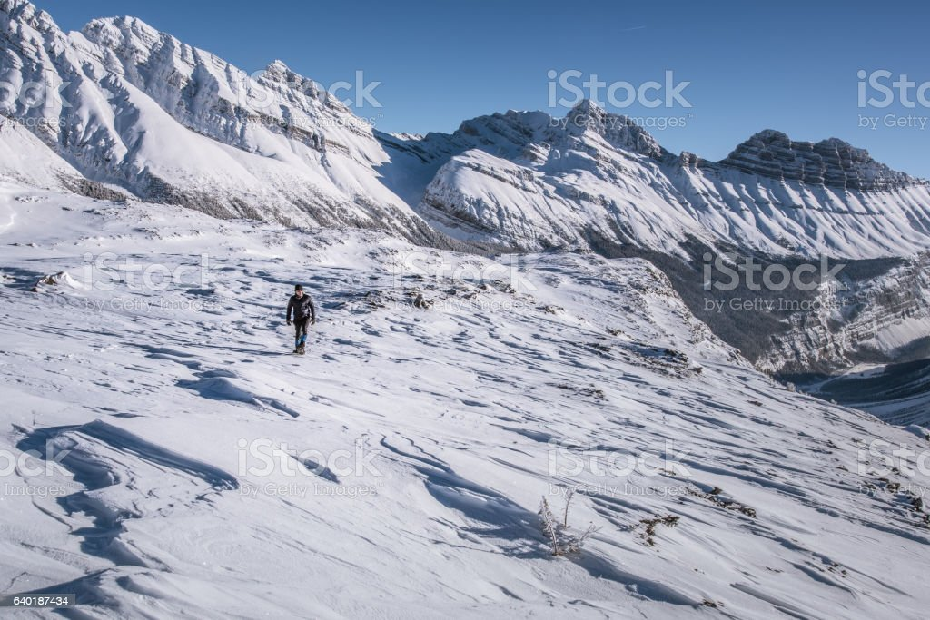 Athabasca glacier snowshoeing in winter, Canadian Rockies, Jasper National Park. stock photo