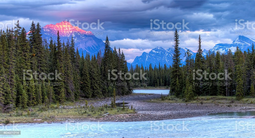 Athabasca River at Sunset with Rocky Mountains in Background stock photo