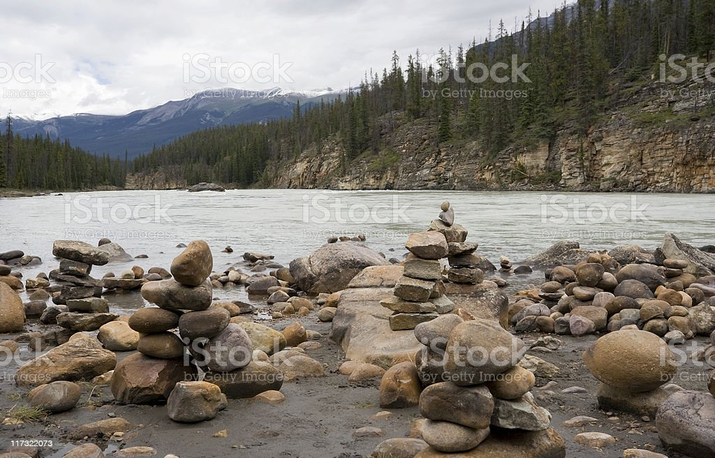 athabasca river with stacks of rocks royalty-free stock photo
