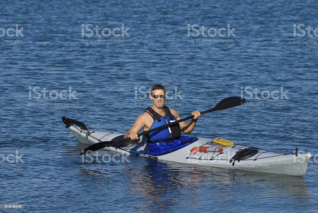 Atheltic man in a sea kayak royalty-free stock photo