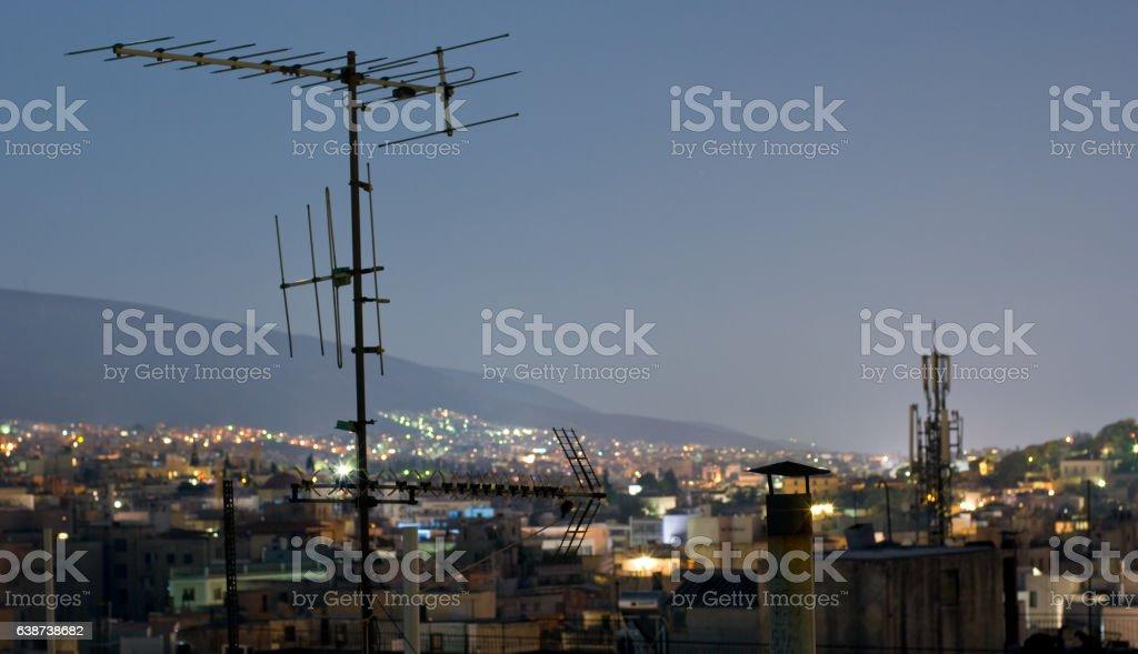 Athens night panorama with antennas. stock photo