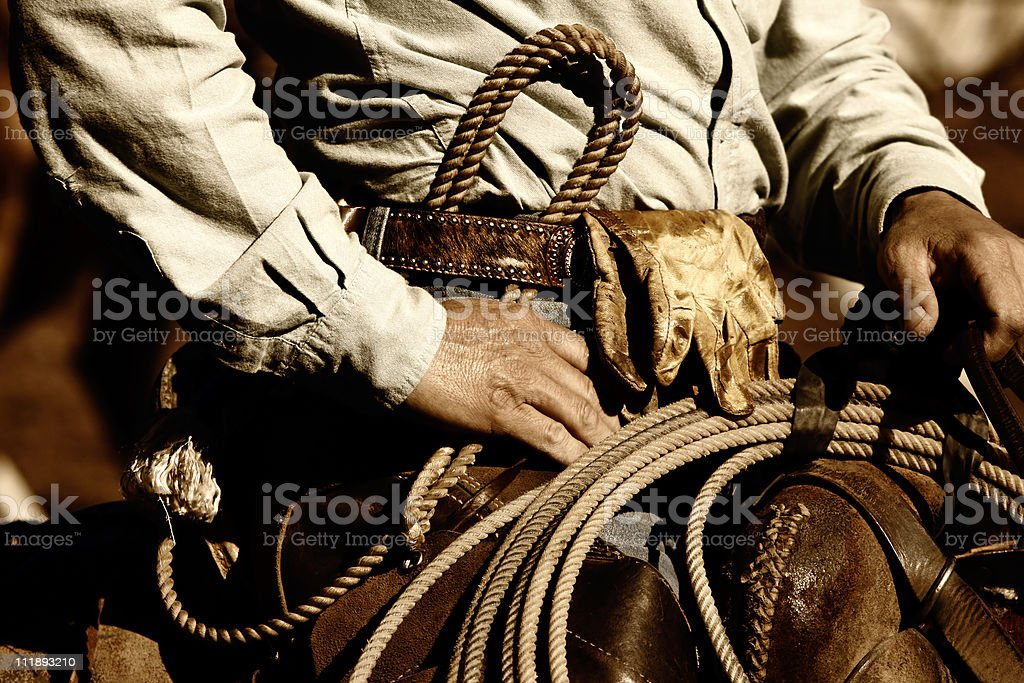 Athentic Working Cowboy Riding in Sunset Light stock photo