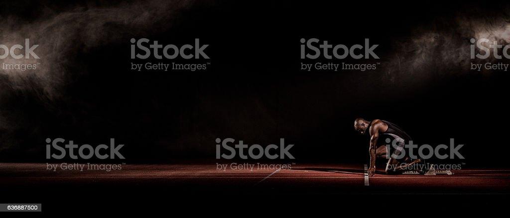 Athlete at starting line stock photo