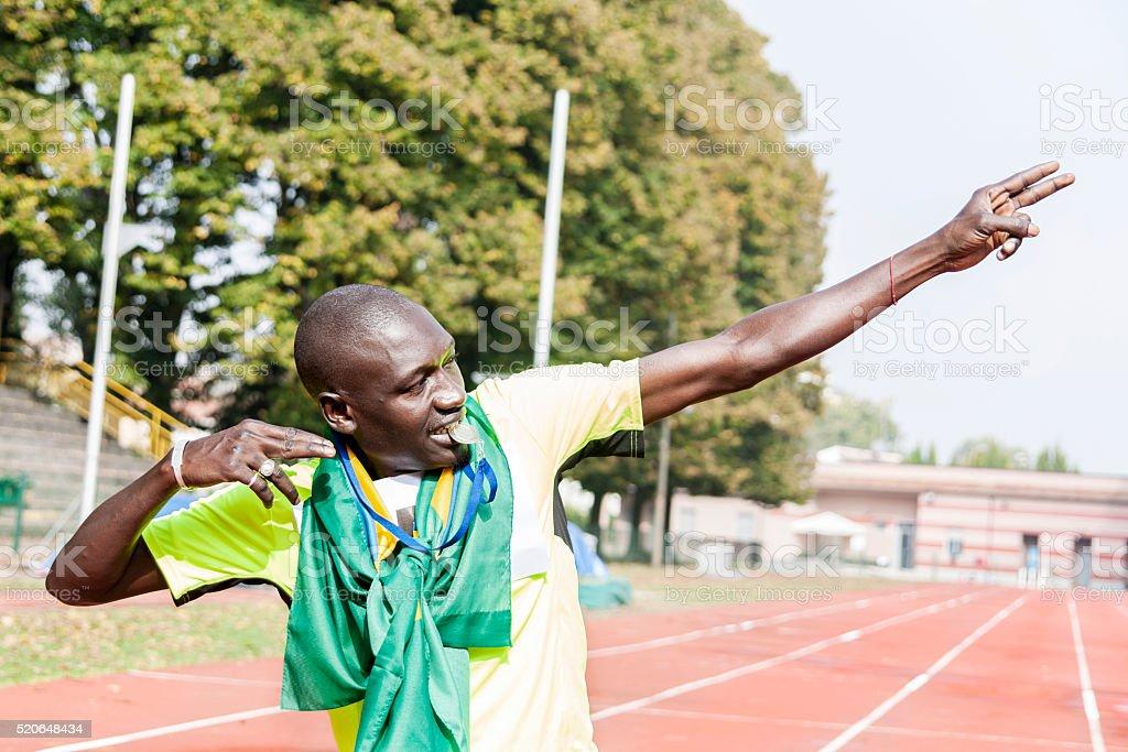 athlete celebrates victory stock photo