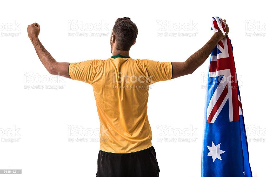 Athlete celebrating and holding the flag of Australia stock photo