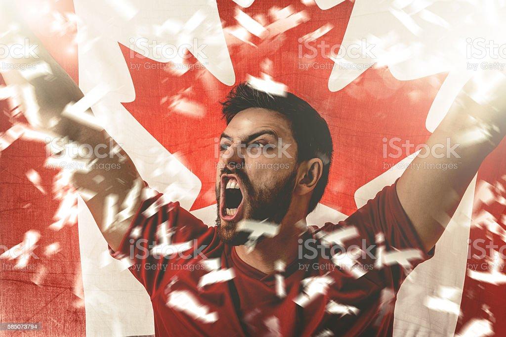 Athlete celebrating and holding the flag of Canada stock photo