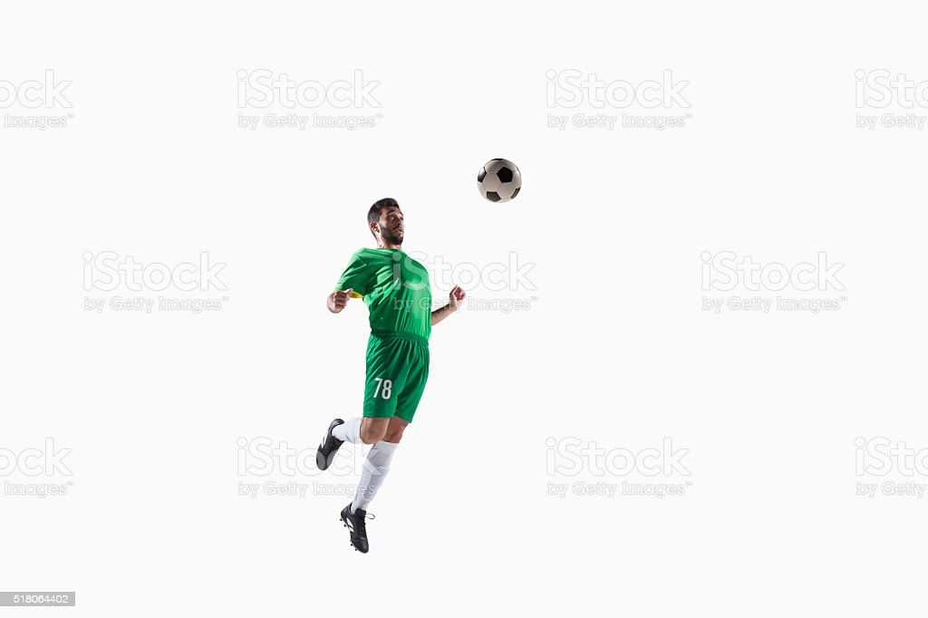 Athlete chesting soccer ball stock photo