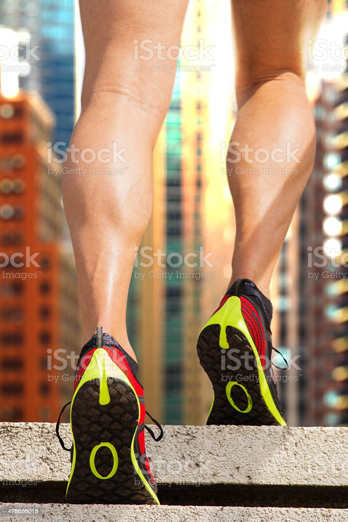 Athlete climbs up stairs stock photo