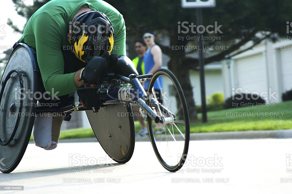 Athlete Competes In Wheelchair Division of Marathon royalty-free stock photo