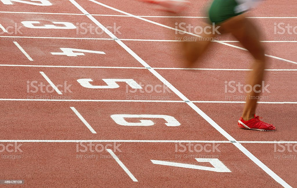 Athlete Crossing the Finish Line stock photo