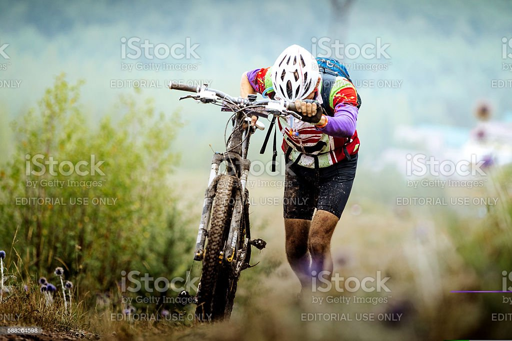 athlete cyclist walking uphill royalty-free 스톡 사진