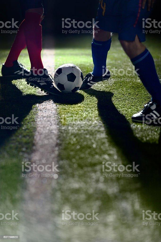 Athlete dribbling soccer ball on field stock photo