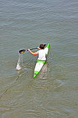 Athlete enjoy outdoors sports, he rowing in the Po