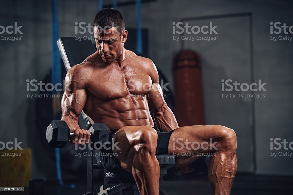 Athlete Exercise with weights stock photo