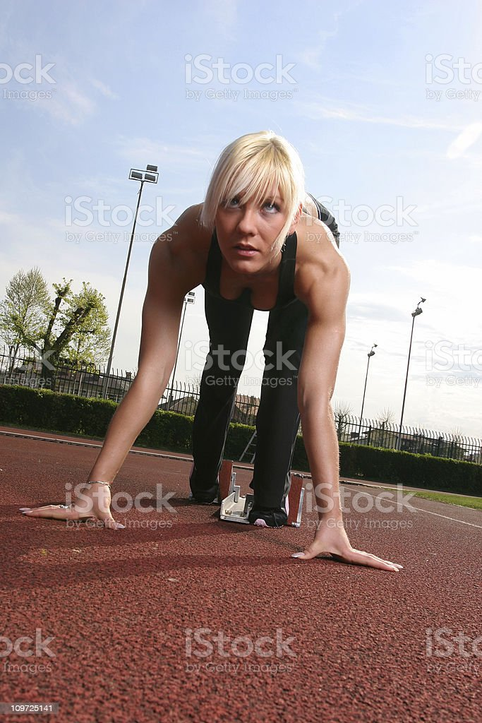 Athlete female starting a race royalty-free stock photo