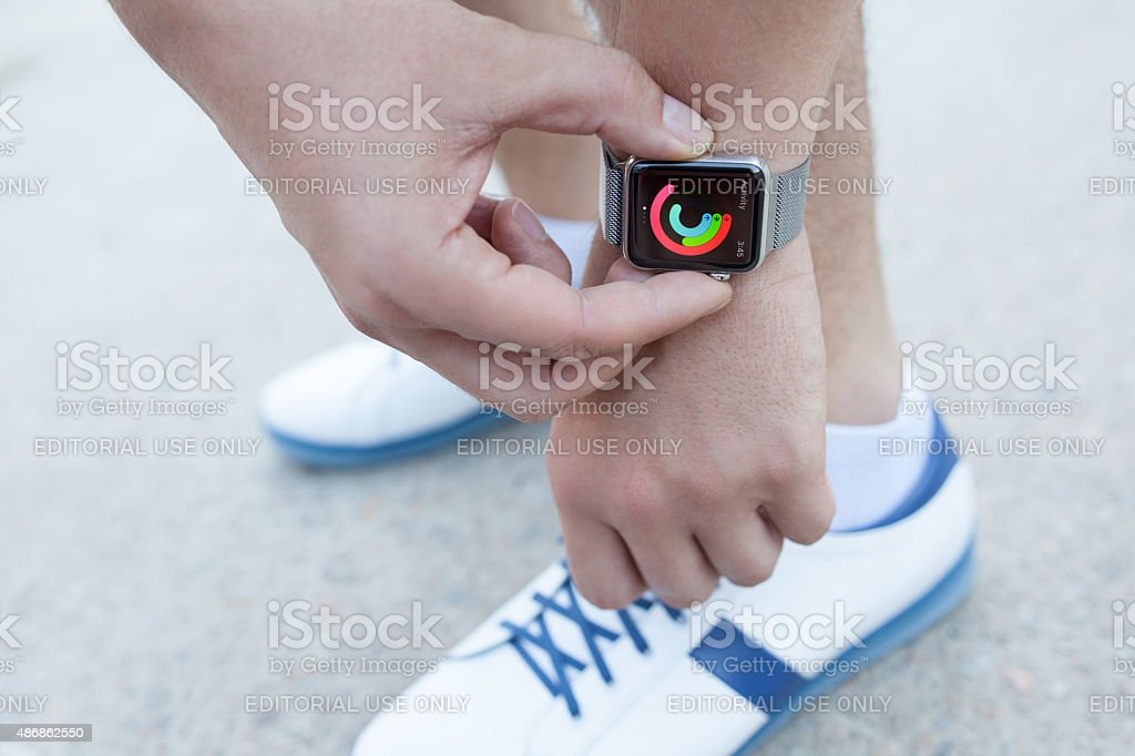 Athlete hand with Apple Watch and app Activity on screen stock photo