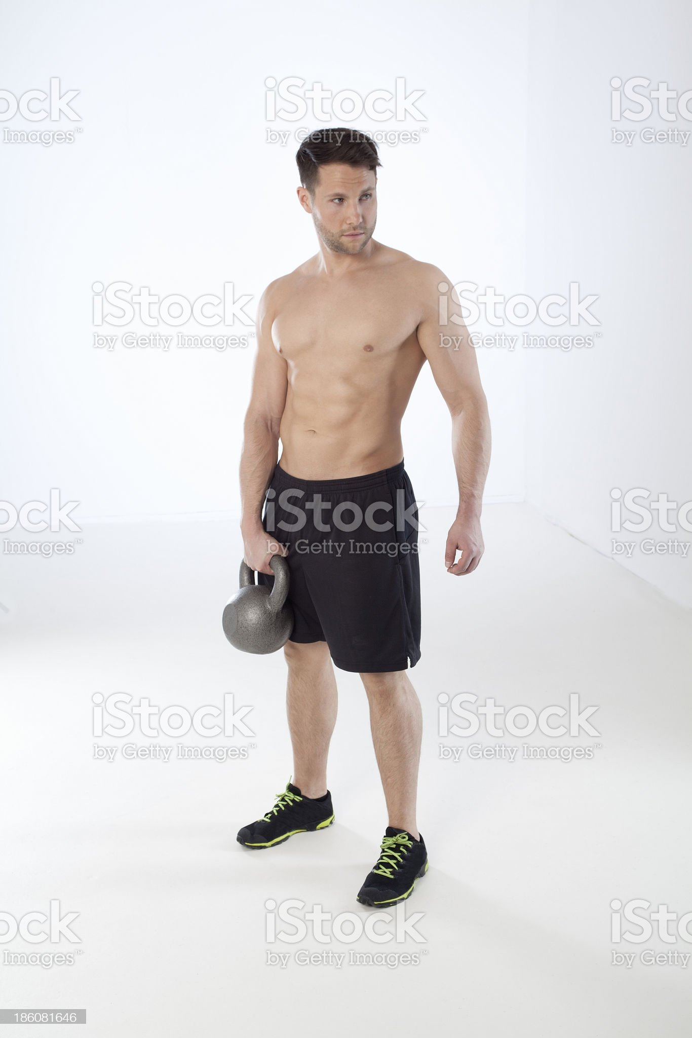 Athlete holding kettle bell royalty-free stock photo