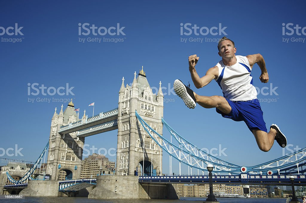 Athlete Hurdles Tower Bridge London stock photo
